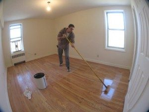 Hardwood Floors Buffing. Applying polyurethane over wood flooring.